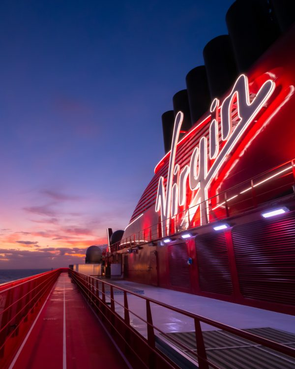 Virgin sign illuminated with a view of a gorgeous sunset over The Runway. (credit: @ginajoyphoto)